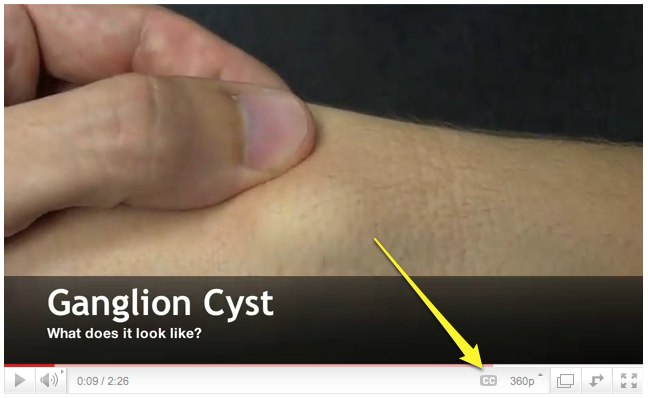 arrow showing captioning button on YouTube video